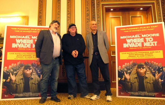 After the press conference, producer Carl Deal (left), Michael Moore and executive producer Rod Birleson (right)
