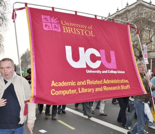 Bristol University UCU members with their banner on a TUC demonstration against austerity – they are on strike over pay tomorrow