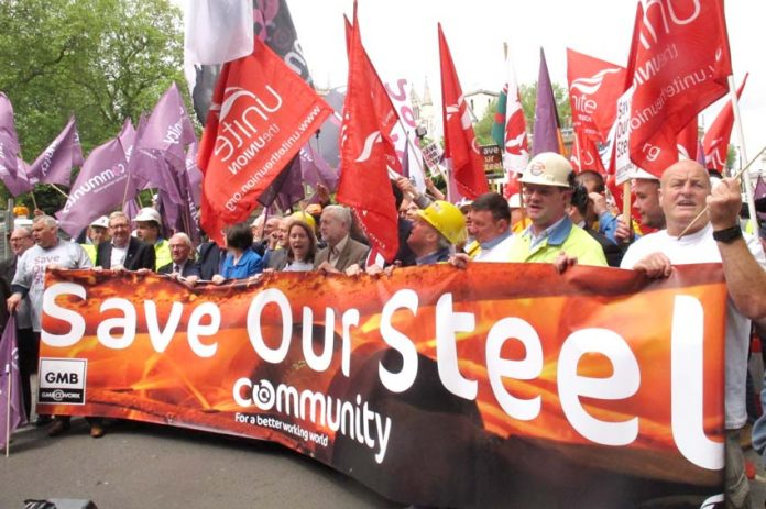 Labour leader CORBYN (centre) with trade union leaders at a demonstration of steelworkers in London