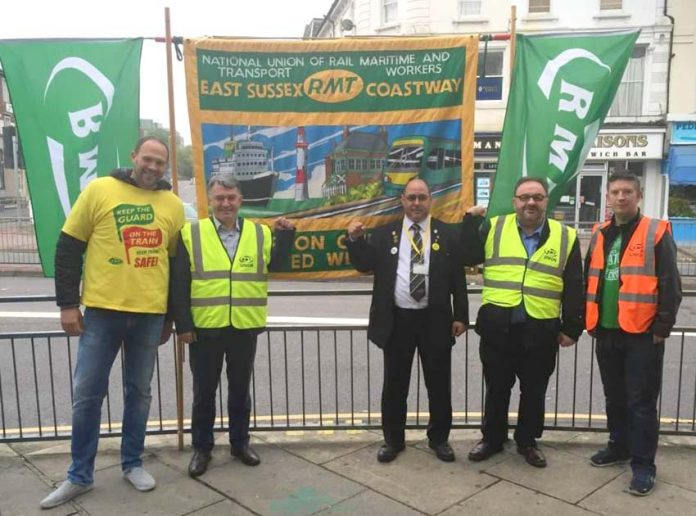RMT General Secretary MICK CASH (second from left) on the picket line at Eastbourne during the Southern rail strike on June 21st