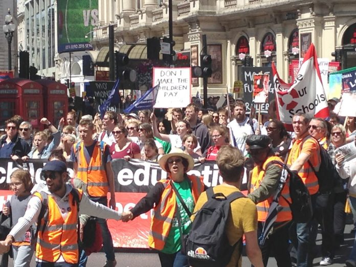 Thousands of teachers march through central London yesterday during their nationwide strike against savage cuts