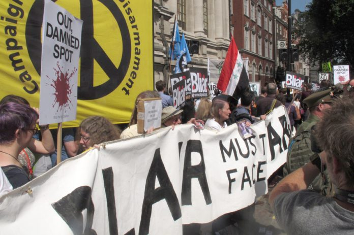 A demonstration outside the QE2 conference centre demanding that Blair must face trial for war crimes
