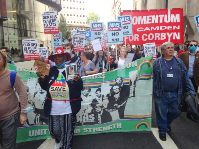 Junior doctors, NHS workers and angry patients march through central London on Thursday evening