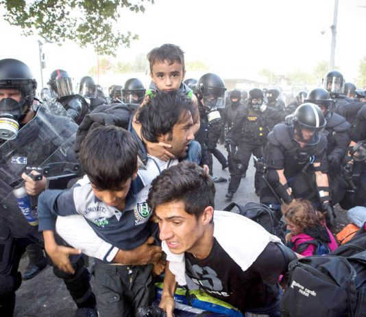 Hungarian police attack refugees on the border with Serbia. Photo credit: DAVID MAURICE SMITH