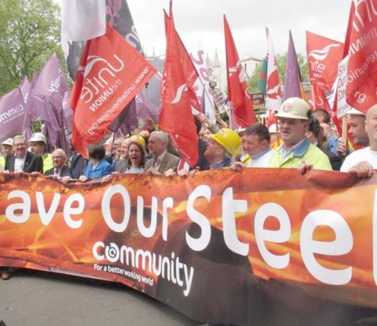 Labour leader CORBYN marching with steelworkers in London in May