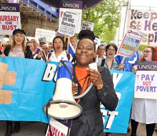 Student nurses marching in London last month shouting 'Hand off our bursaries!' – the RCN calls for all the cuts to be halted