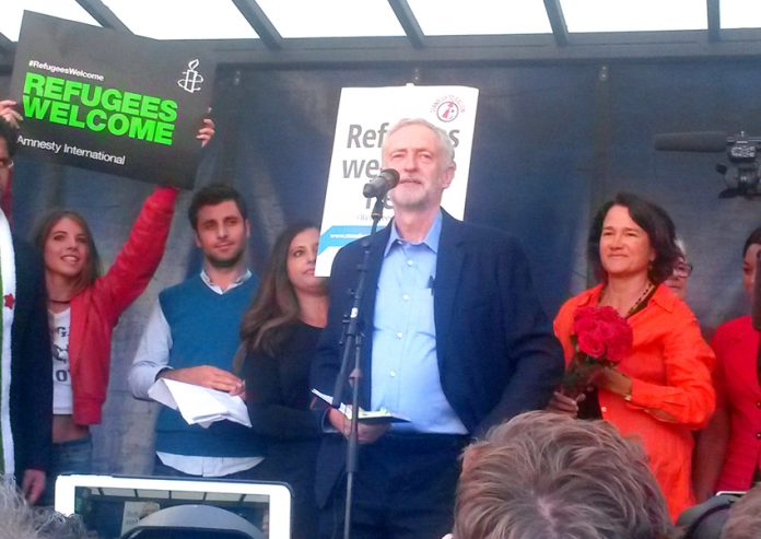 JEREMY CORBYN addressing the 100,000-strong 'Refugees Welcome' rally on the day he was elected Labour leader, last September