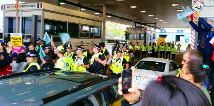 British police working with the French government taking action to stop a convoy boarding a ferry going to Calais
