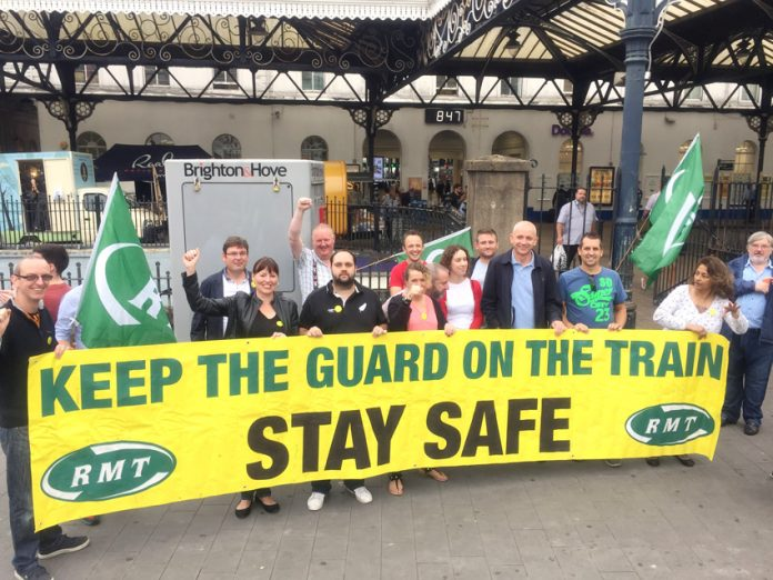 Southern Rail guards on the picket line at Brighton station yesterday morning