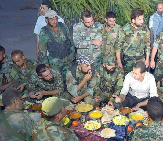 Assad breaks his fast with Syrian troops during Ramadan