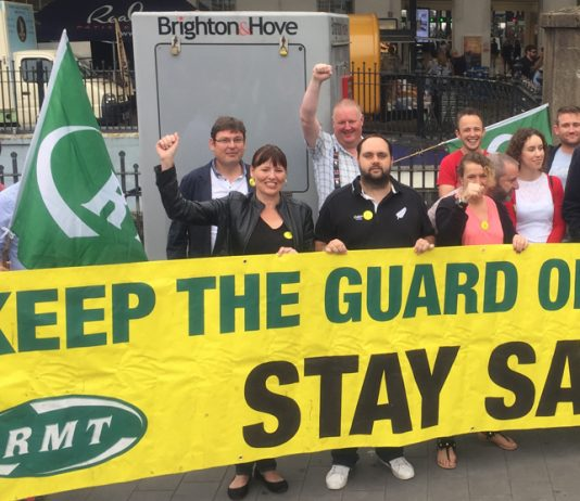 Southern rail workers during their strike to keep the guard on the train picketing outside Brighton station earlier this month
