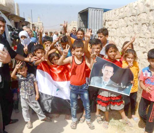 Families in east Aleppo show their support for President Assad