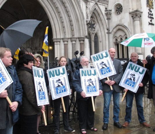 NUJ protest outside London's High Court in 2012 as police tried to force photographers covering the eviction of Travellers from their site at Dale Farm in east London to hand over all their images of the eviction