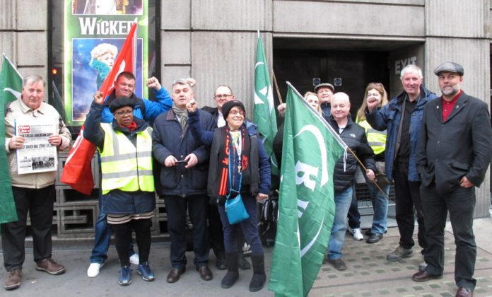TUC deputy general secretary PAUL NOVAK (back row, centre) was among the enthusiastic pickets at Victoria Station yesterday morning. He brought the support of the General Council