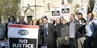PCS leader MARK SERWOTKA (centre) at a rally against cuts