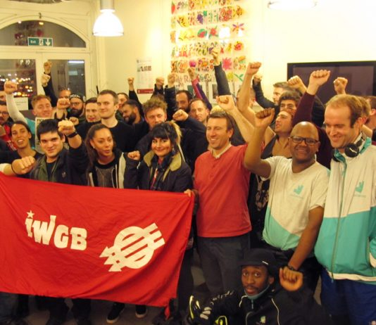Deliveroo riders at Tuesday night's meeting with the Independent Workers Union of Great Britain banner