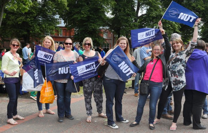 Strking teachers in Norwich assemble before going on a demonstration