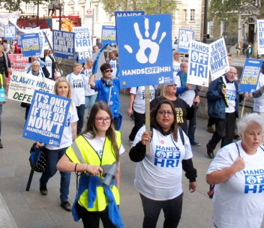 Workers from Huddersfield Royal Infirmary marching to 10 Downing Street to tell PM May that their hospital must remain open and fully functioning