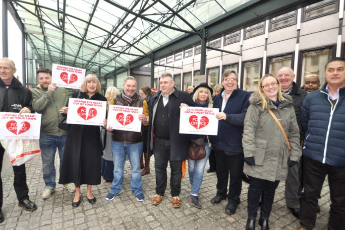 Postal workers among the 100-strong rally outside the Department of Business, Energy and Industrial Strategy demanding no closures of Crown Post Offices