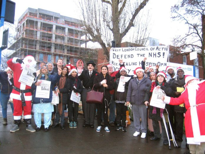 Lively mass Xmas picket of Ealing Hospital yesterday morning demanding that the STP closure plans are thrown out