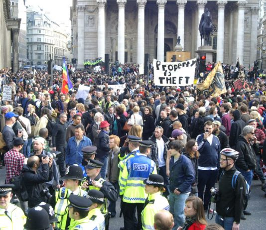Workers demonstrate outside the Bank of England in 2009 – they are still paying the price for the bankers' crash