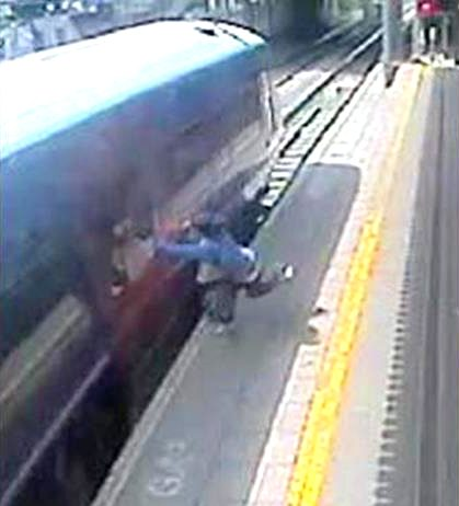 Passenger with hand trapped in train door being dragged along the platform