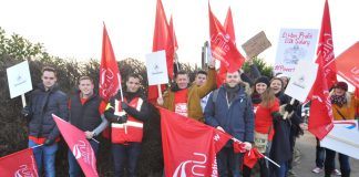 Striking BA cabin crews leaving yesterday's early morning rally to set up picket lines around Heathrow Airport