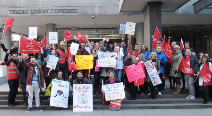Striking cabin crew rally on the steps of the TUC in Great Russell Street