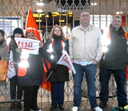 Tube staff picketing Finsbury Park station during one of their strike actions against staff cuts that endanger public safety