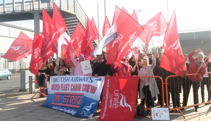 Striking BA mixed fleet cabin crew on the picket line at Heathrow Airport yesterday morning