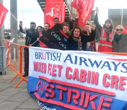 Striking BA mixed fleet cabin crew on the picket line at Heathrow Airport yesterday during their latest 4-day strike over pay