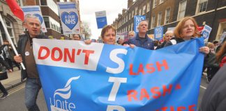 Unite members marching against the STP plans – the budget promises to speed up the STP attack on the NHS