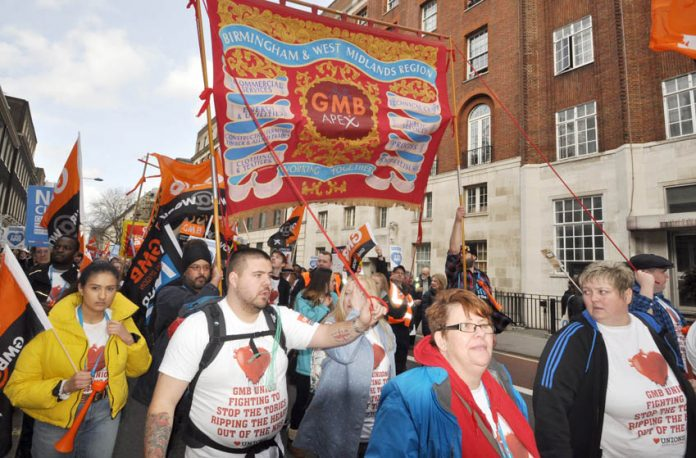 GMB members marching to defend the NHS – the GMB is playing a leading role in the fight against the privatisation of Barnsley Hospital