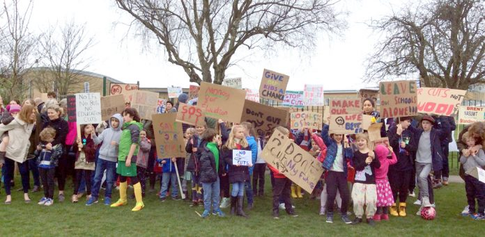 Parents, children and teachers demonstrated against the cuts to schools funding last Saturday, organised by Kenmont primary school, and taking place in Tiverton Park, Paddington
