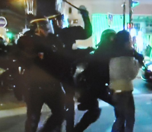 CRS riot police clash with protesters for a third night against the police killing of a Chinese man on Sunday