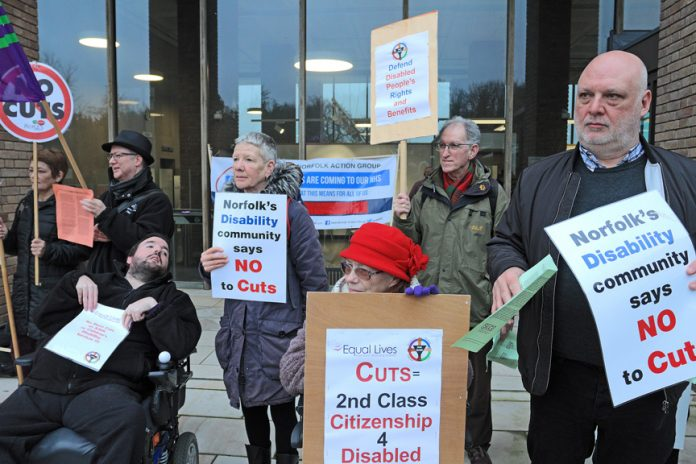 Disabled claimants protesting in Norwich in February – new claimants now face a £30 a week cut to their benefit