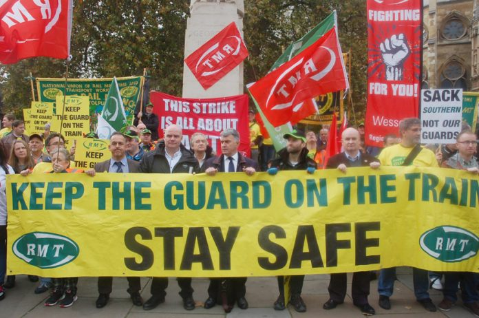 RMT and supporters demonstrate outside the House of Commons for passenger safety, insisting guards must be kept on the trains