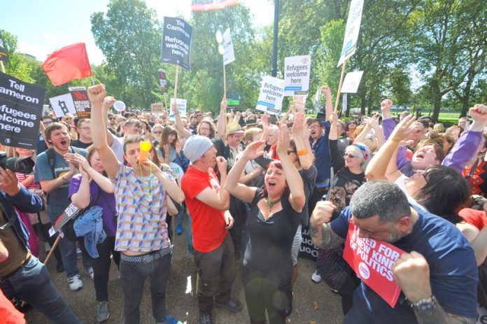 Crowds of supporters celebrate the election of Jeremy Corbyn as Labour Party leader at the Refugees Welcome march in September 2015