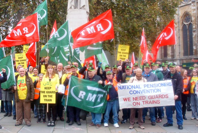 RMT Southern rail guards and supporters lobbying parliament last November demanding that guards must be kept on the trains