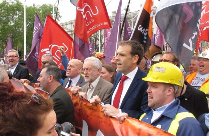 Labour leader CORBYN marching with steel workers in defence of jobs