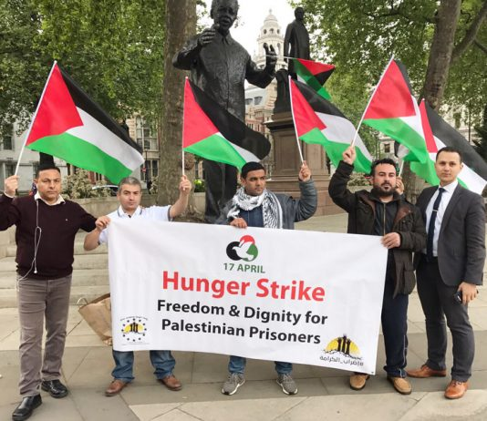 AYSAR SHAMALLAKH (left) launching his hunger strike at 6.00pm on Tuesday 2nd May in Parliament Square under the statue of Nelson Mandela in solidarity with 1,600 Palestinian prisoners of Israel
