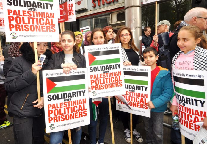 Youth at the picket in support of Palestinian hunger strikers outside the Israeli embassy in London last Saturday