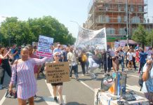 Marchers on behalf of Grenfell Tower fire victims setting off to Parliament from Shepherd's Bush Green yesterday