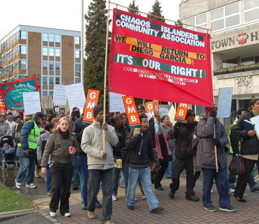 Chagos Islanders marching in Crawley, Sussex – they demand the right to return to their home islands