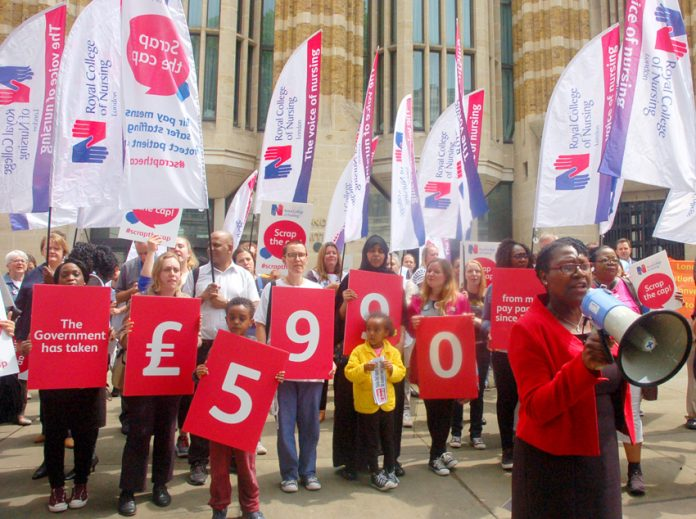 RCN London Board Chair CYNTHIA DAVIS addressing nurses protesting outside the Department of Health in Whitehall yesterday