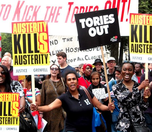 "Protesters on Saturday's ""Tories Out' march demand 'Justice for Grenfell'"