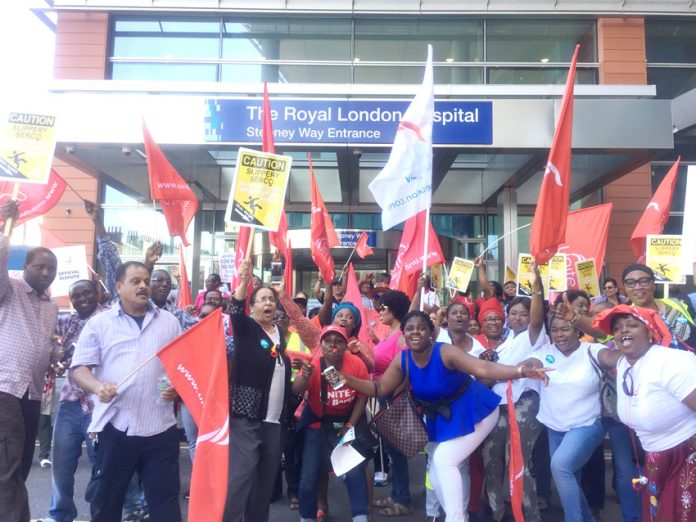 Striking Serco workers outside The Royal London Hospital in Whitechapel yesterday on the second day of their 48-hour strike