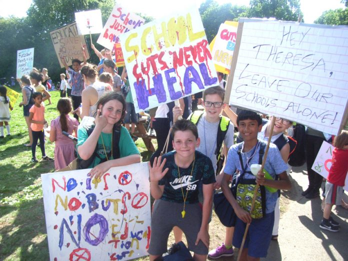 School children from the London Borough of Wandsworth at a demonstration on Tooting Common fighting Tory education cuts