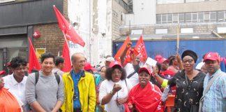 Junior doctors leader JEEVES WIJESURIYA (2nd left) joins SERCO strikers yesterday on the picket line at the Royal London Hospital