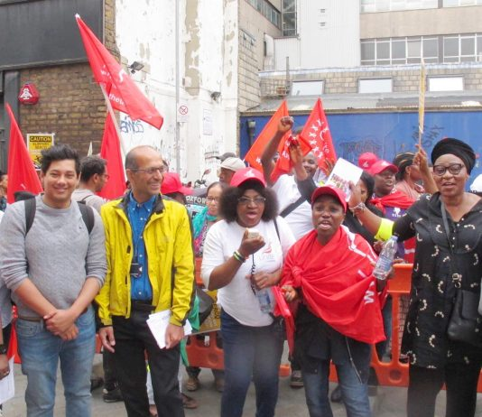 Junior doctors leader JEEVES WIJESURIYA (2nd left) joins SERCO strikers yesterday on the picket line at the Royal London Hospital